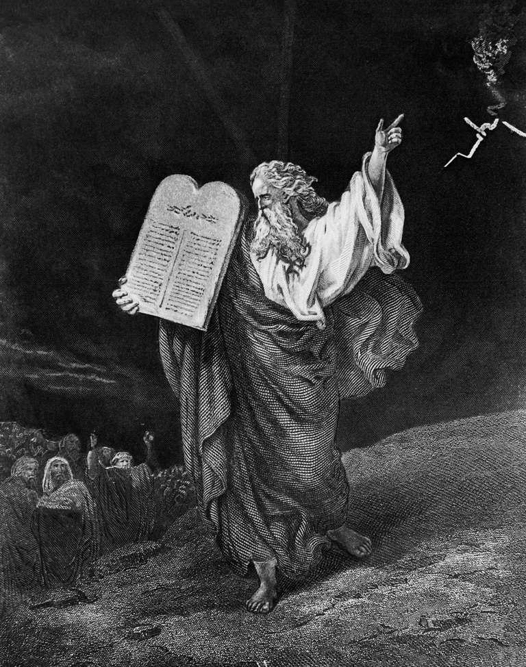 Moses carrying Ten Commandments down Mount Sinai