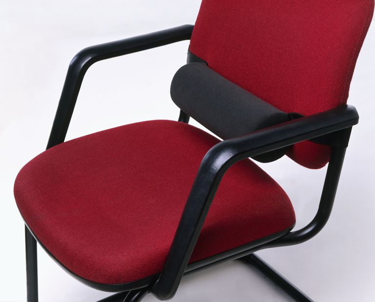 Red office chair with back support, close-up