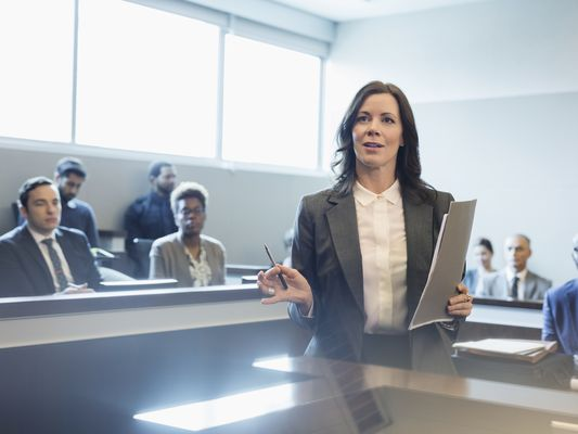 Female attorney talking in legal trial courtroom