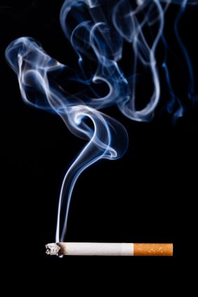 smoke rising off the end of a cigarette