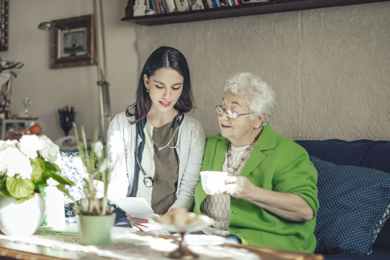 Social worker is visiting a senior woman at home