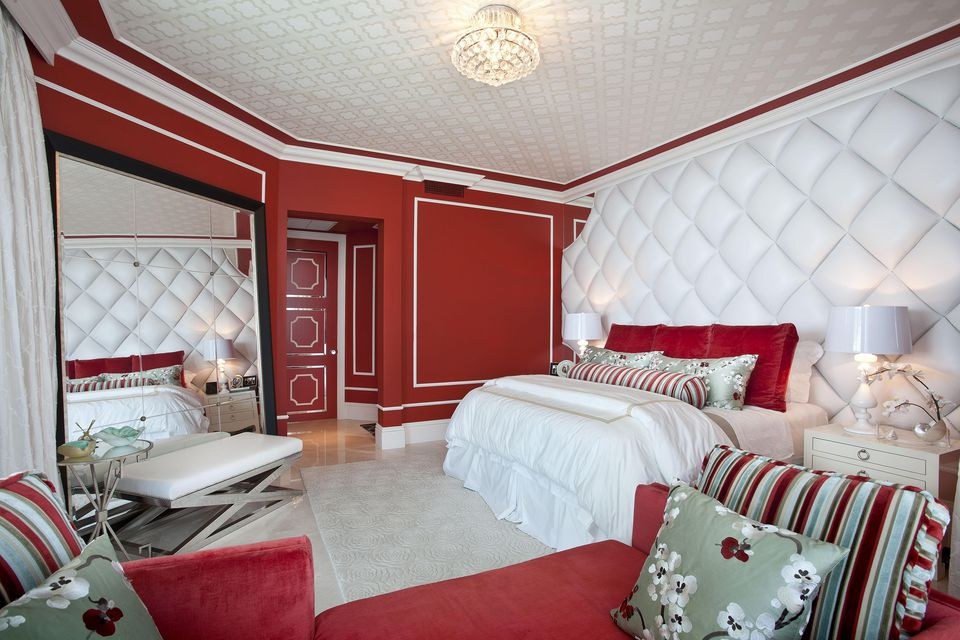 Eclectic Red Bedroom by DKOR Interiors Inc.