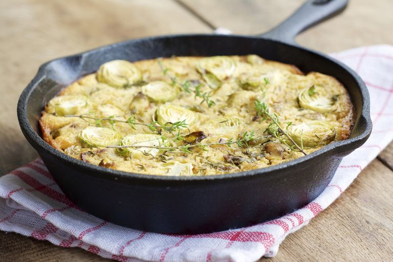 Brussels Sprout Frittata with leek and chickpea flour in a cast iron skillet