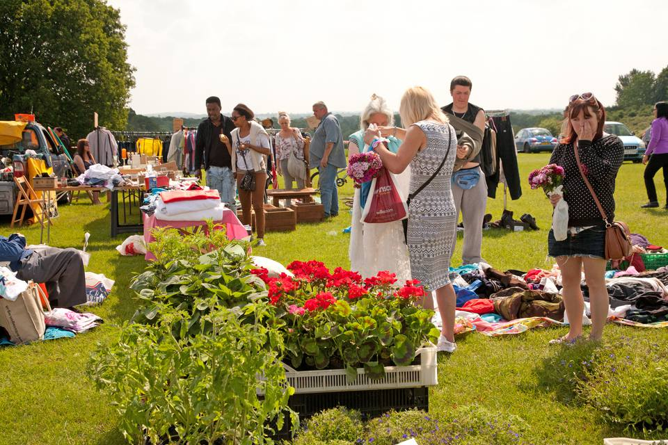 shoppers at highway yard sale