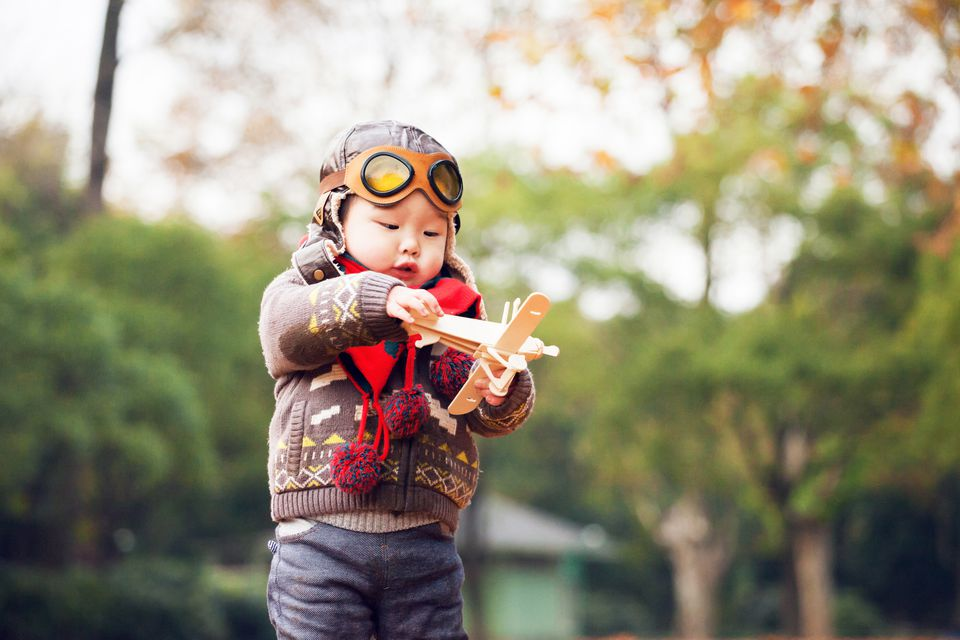 Little boy playing plane toy