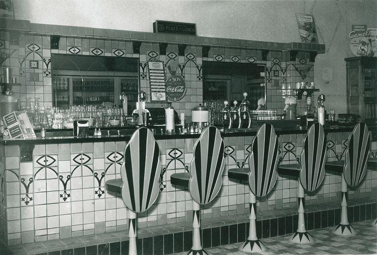 Soda fountain at counter.