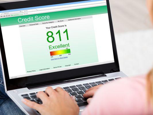 Woman Checking Credit Score Online On Laptop