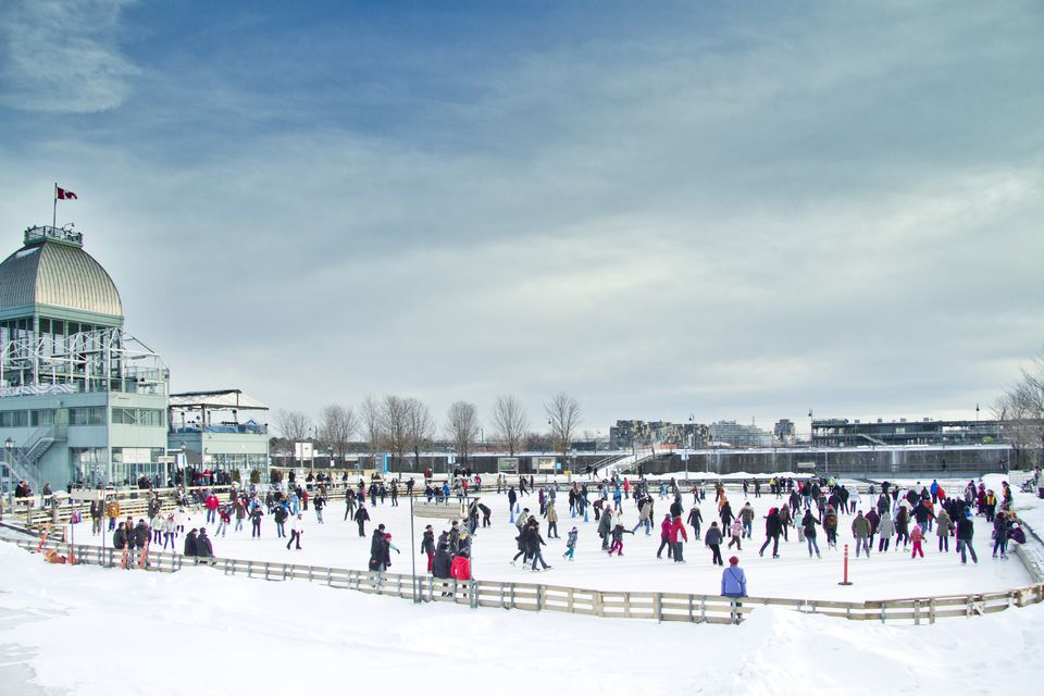 People skating on ice rink in Old port of Montreal