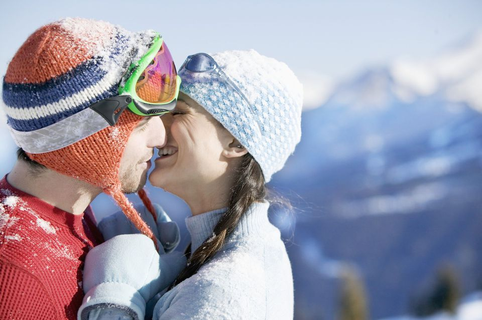 young couple kissing in ski gear