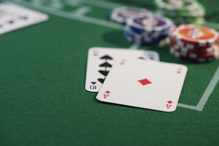Cards and gambling chips on playing table