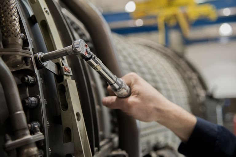 using a torque wrench on a jet engine
