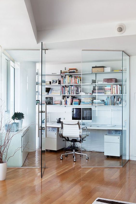 Home office enclosed in glass walls
