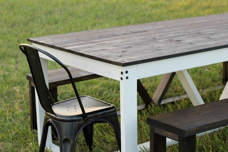 Picture of a farmhouse table outside. 12 Free DIY Woodworking Plans for a Farmhouse Table