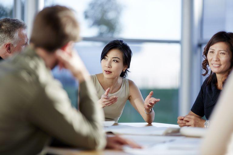 Business people talking in meeting.