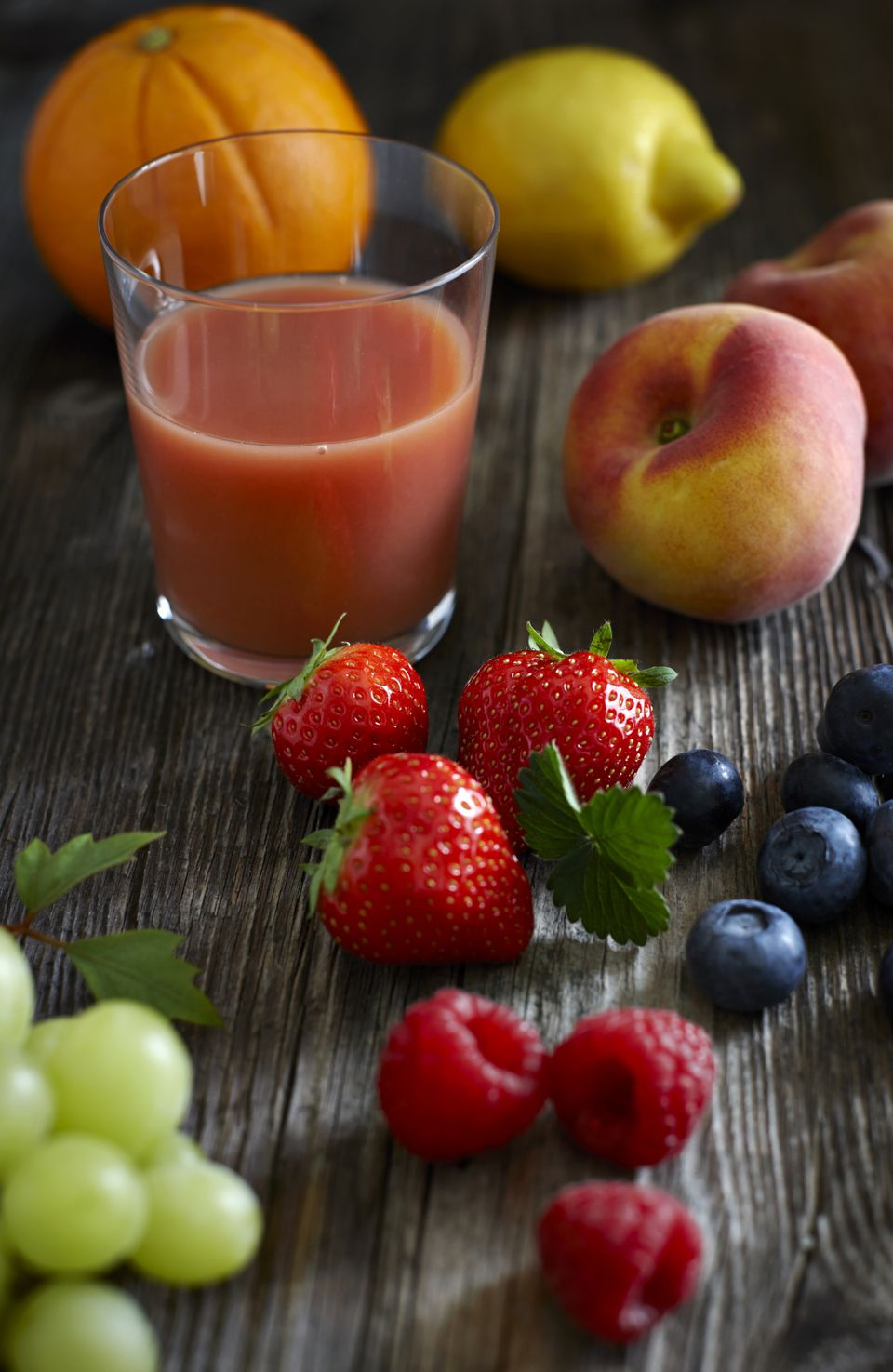 A smoothie surrounded by its component fruit
