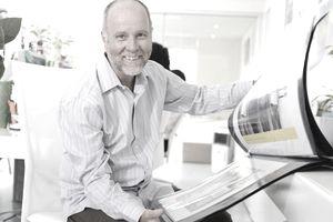 Art director showing portfolio, portrait, in office