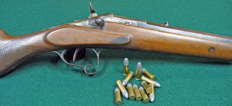 H. Pieper Flobert-Warnant single-shot 32 rimfire rifle, right side close-up, and .32 rimfire ammo.
