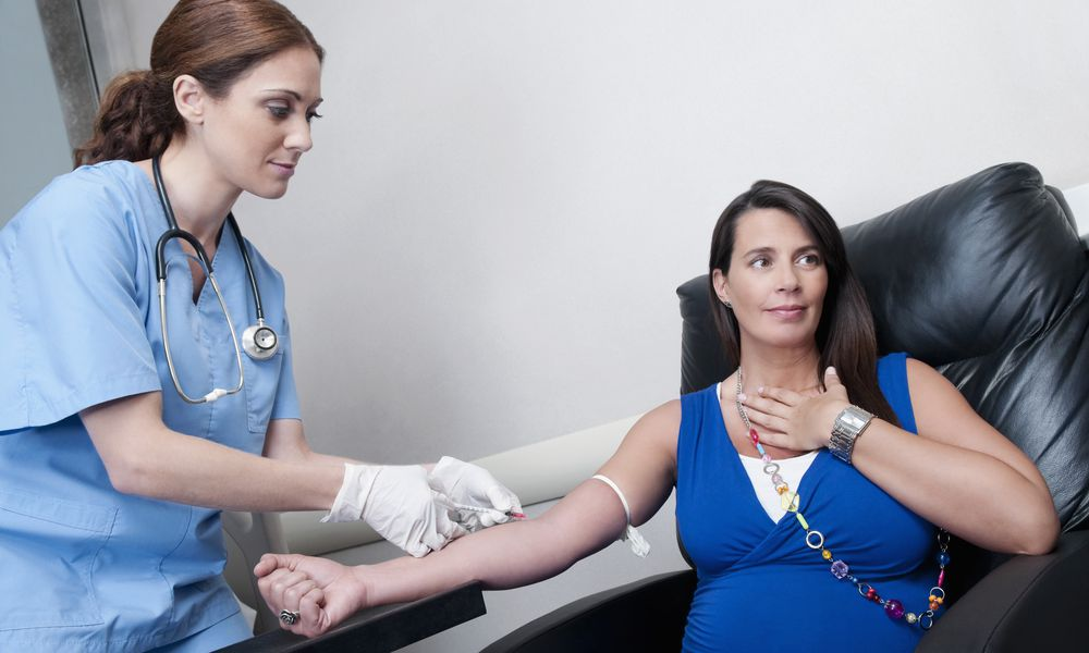 Pregnant woman getting her blood drawn