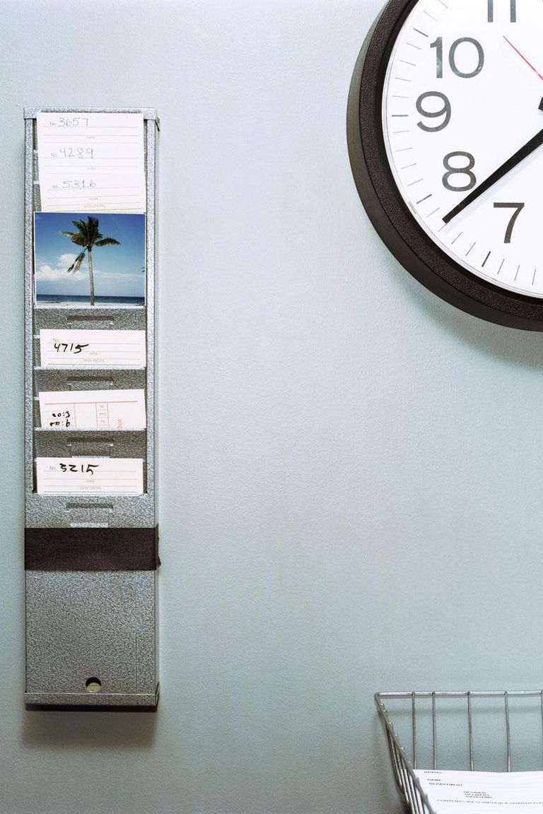 Palm tree postcard in employee timecard slot.