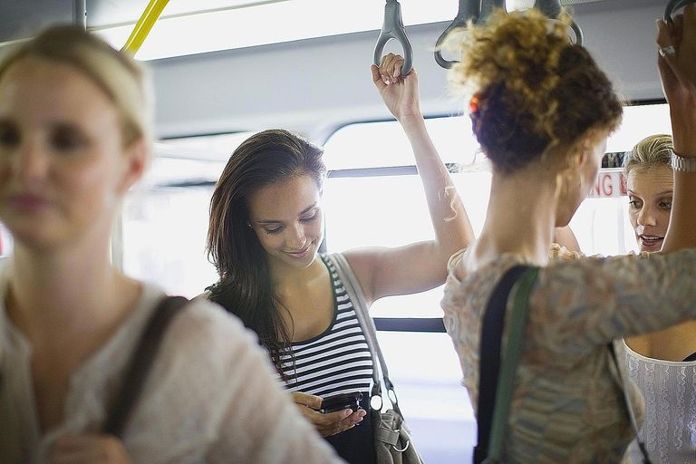 A collection of women riding a bus together represent the concept of a social aggregate within sociology.