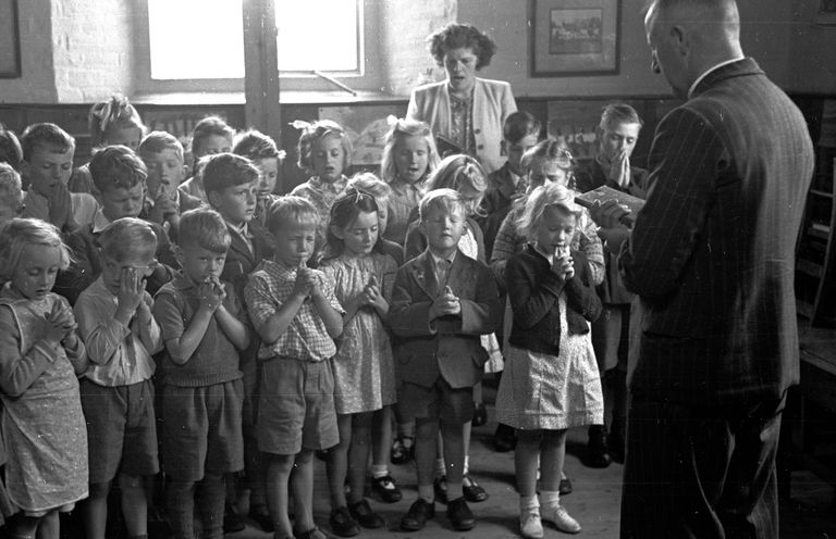 School children in 1948 being led in prayer by a teacher