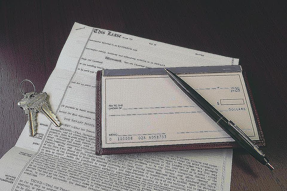 Lease with checkbook and house keys
