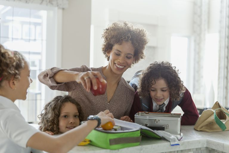 school lunch box ideas - mother and daughters packing lunch box