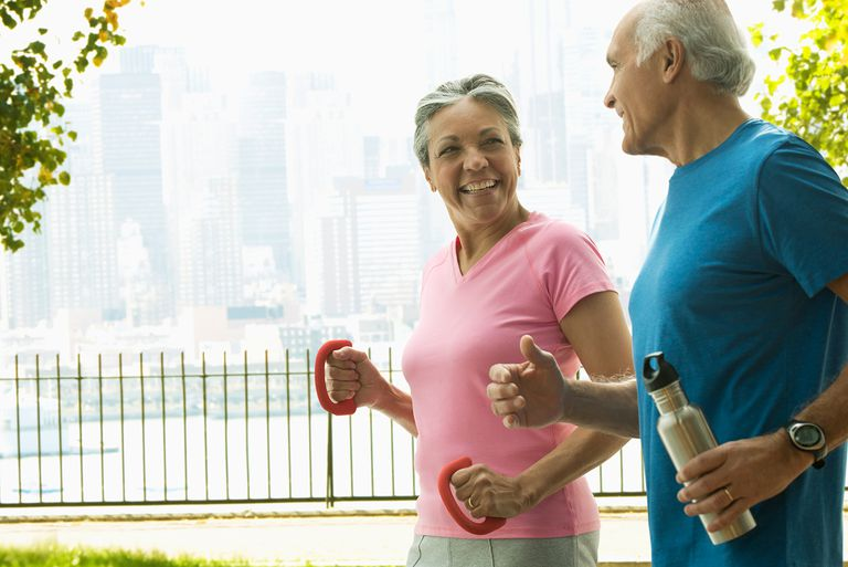 Older Hispanic couple working out in urban park