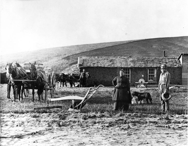 Black and white photo of a pioneer family on their Nebraska homestead