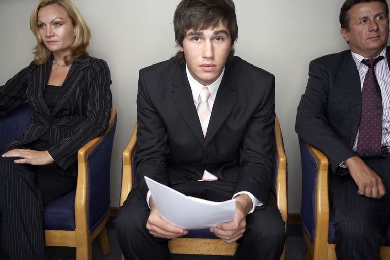 Young man anxiously awaiting a job interview