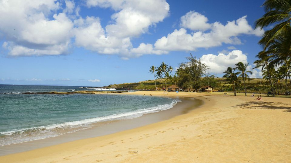 A few visitors enjoy Salt Pond Beach Park, Hanapepe, Kauai