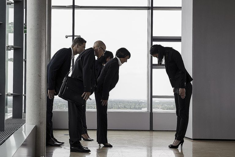 business group greeting each other
