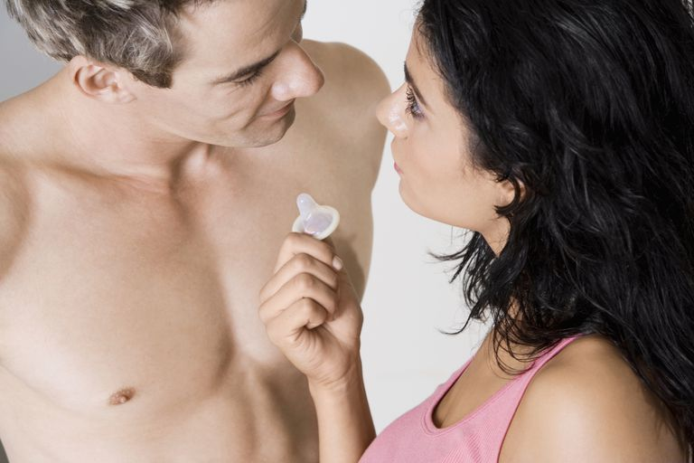 Man and woman holding a condom
