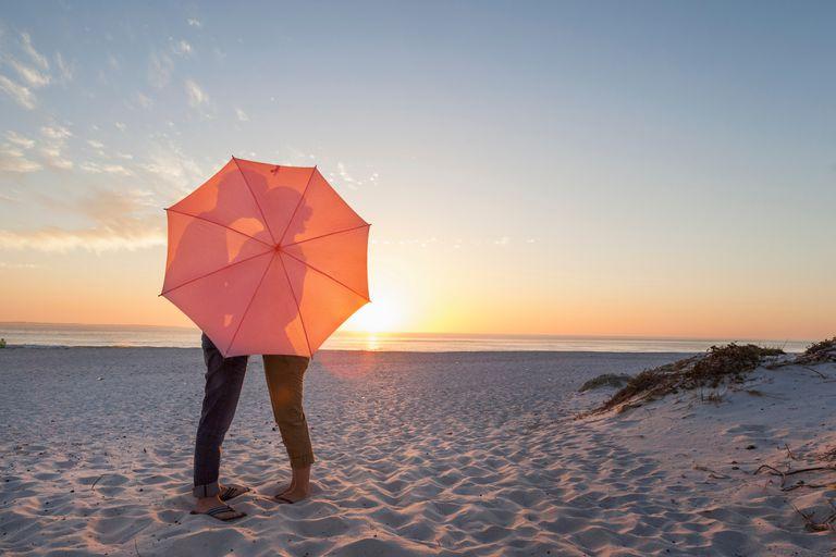 Couple Behind Umbrella