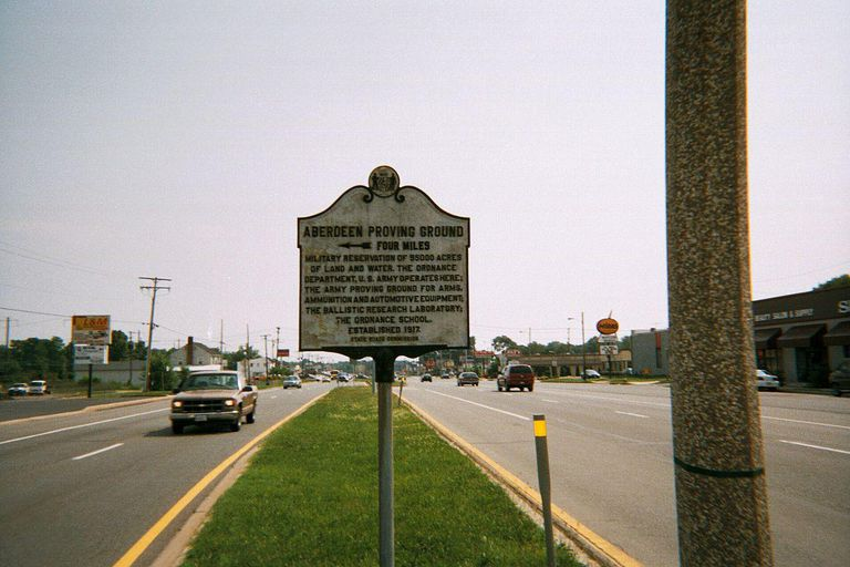 Historic plaque about the Aberdeen Proving Ground on the median of U.S. Route 40 in Aberdeen, Maryland.