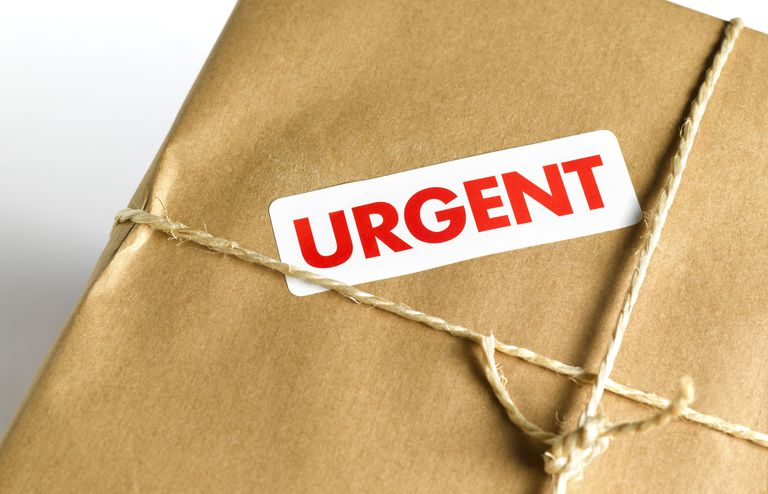 Photo of a package with the words URGENT on it