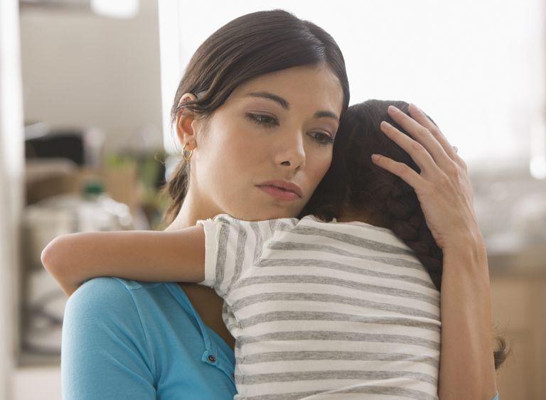 Sad mother hugging child