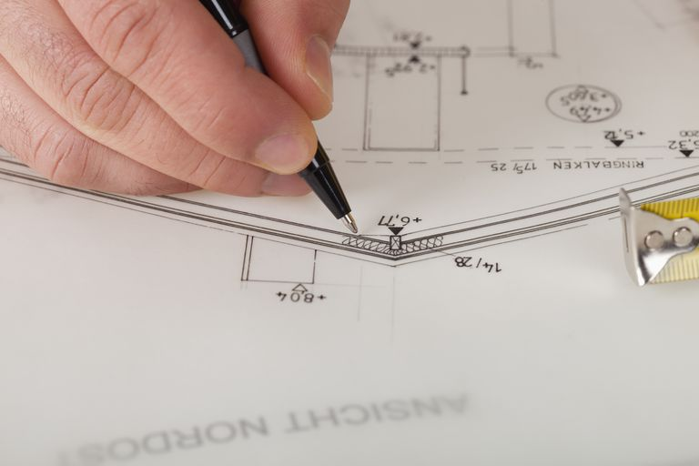 Architect blueprint Close up detail drawing hands
