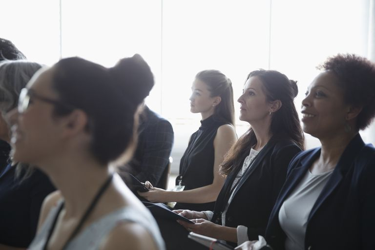 Attentive women listening in conference audience