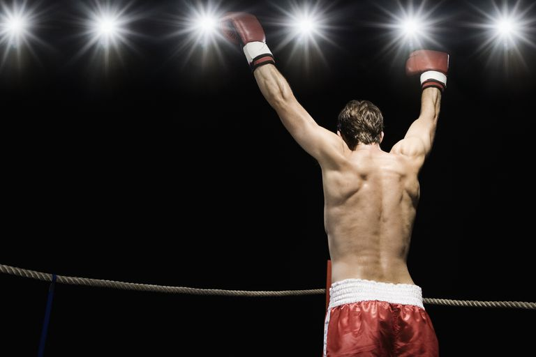 boxer holding up arms triumphantly