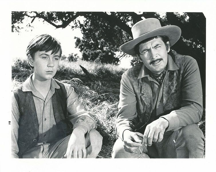 Actors Tommy Kirk (l) and Fess Parker who starred in the Disney movie 'Old Yeller'