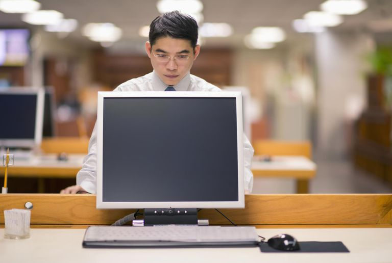 Man using a computer in library