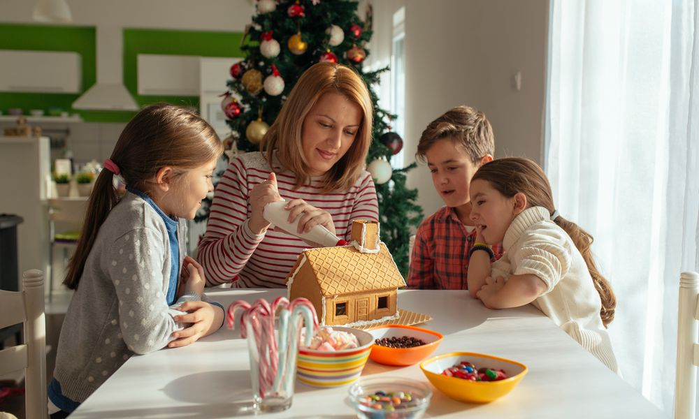 Decorating gingerbread house as family