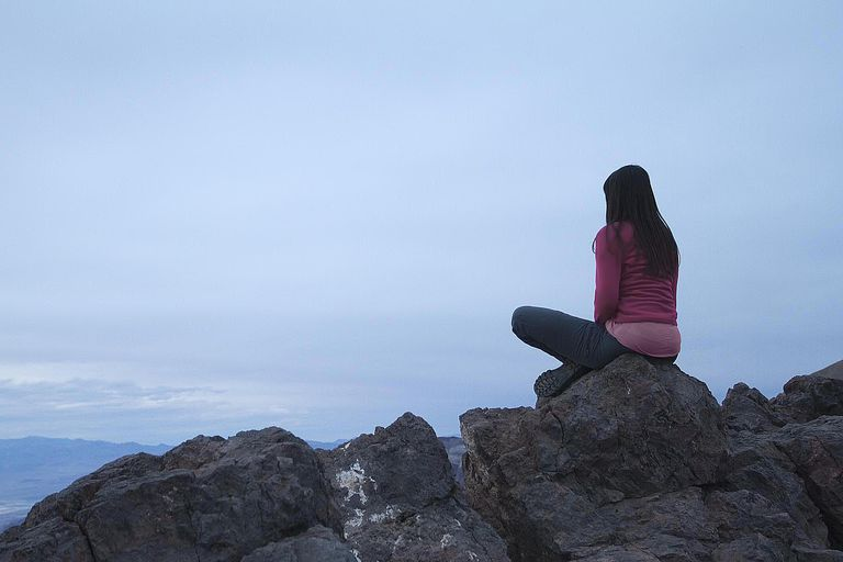 Girl Sits on a Rock