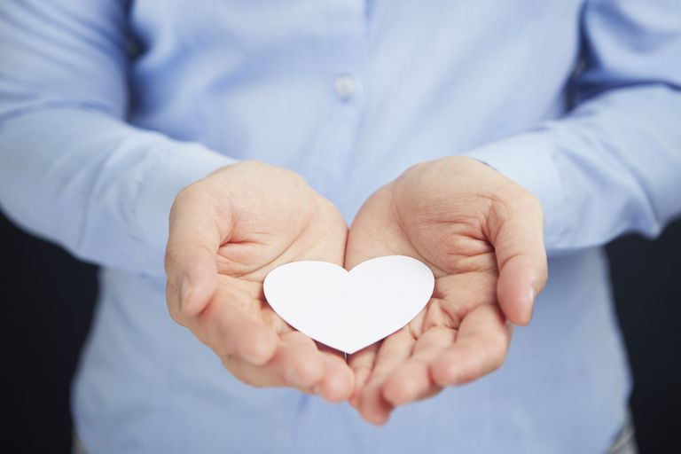 Cupped hands with a heart