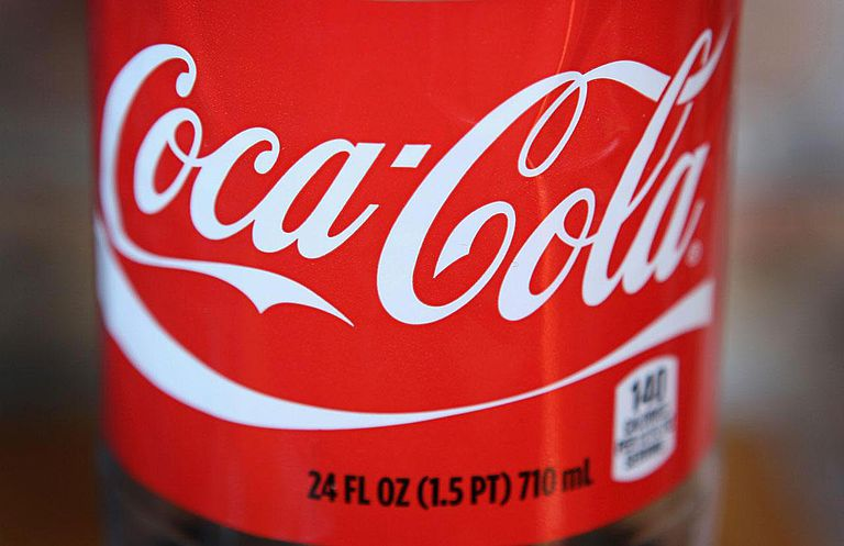 The Coca-Cola logo is printed on the lanel of a 24-ounce bottle of soda on April 17, 2012 in Chicago, Illinois.