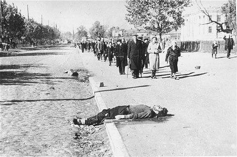Jews, on their way out of the city of Kiev to the Babi Yar ravine, pass corpses lying on the street.