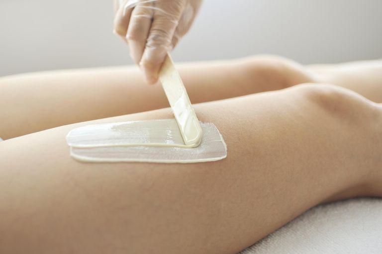 Woman receiving a Brazilian wax hair removal