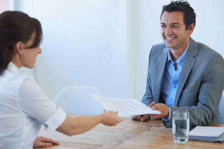 Handing resume to interviewer at job interview