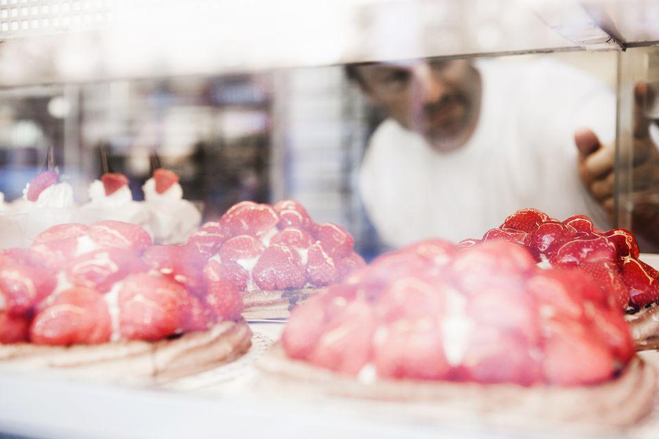 Man behind bakery glass